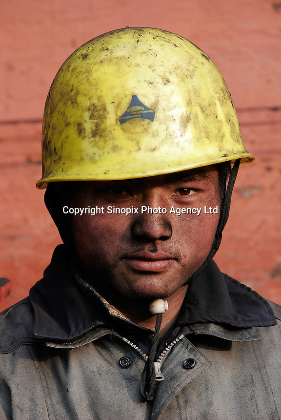 Portrait of a dock worker at a shipping depot that supplies the local power plants in Shanghai, China. China's breakneck economic growth is causing a dangerous shortage of its most important energy source coal, with potential consequences for the entire world, state media recently warned. China consumes two thirds of the world's total coal output, almost half of which goes into the country's numerous coal-burning power plants..