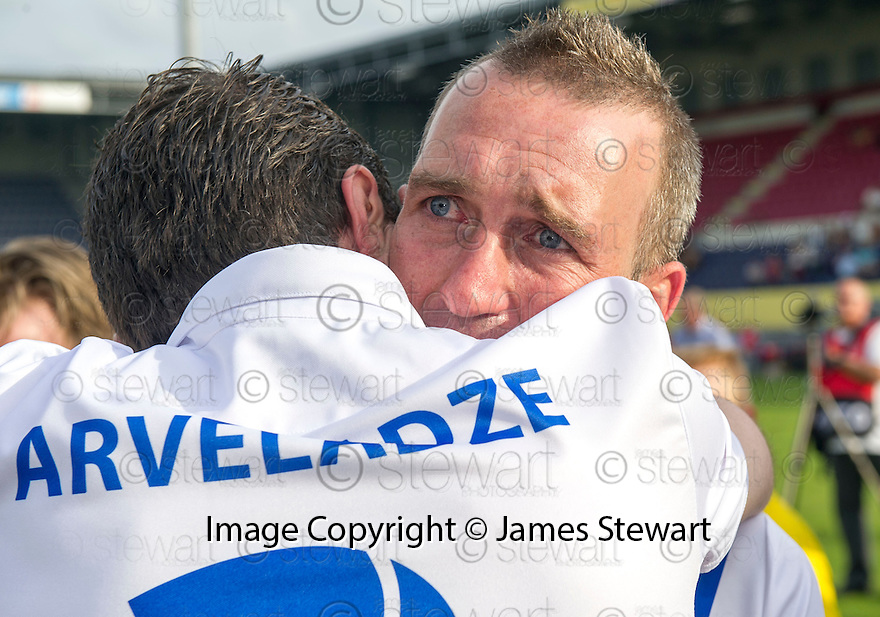 Fernando Ricksen Testimonial : A tearful Fernando Ricksen breaks down as he meets former Rangers' player Shota Arvladze, whilst going along the line up of players before the match..