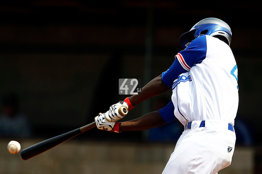 21 June 2011: Fred Hanvi of Team France contacts during UCLA Alumni 5-3 win over France, at the 2011 Prague Baseball Week, in Prague, Czech Republic.