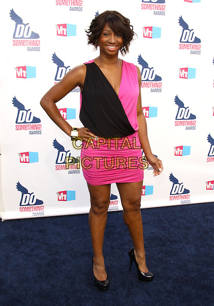 MONIQUE COLEMAN.2010 VH1 Do Something Awards held at the Hollywood Palladium, Hollywood, CA, USA..July 19th, 2010.full length black dress pink sleeveless hand on hip.CAP/ADM/TC.©T. Conrad/AdMedia/Capital Pictures.