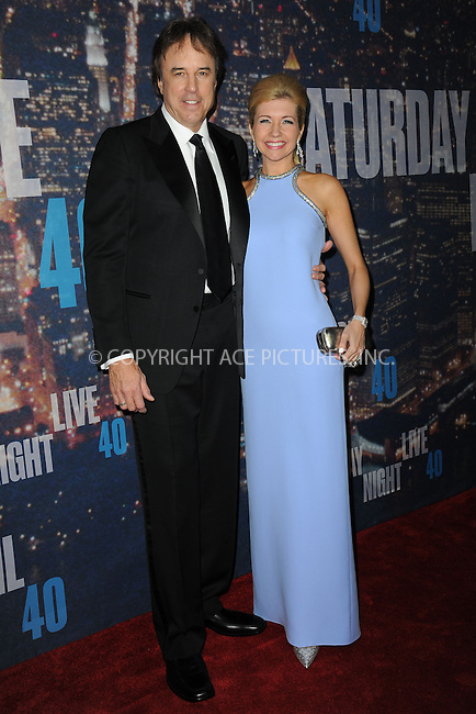 WWW.ACEPIXS.COM<br /> February 15, 2015 New York City<br /> <br /> Kevin Nealon and Susan Yeagley walking the red carpet at the SNL 40th Anniversary Special at 30 Rockefeller Plaza on February 15, 2015 in New York City.<br /> <br /> Please byline: Kristin Callahan/AcePictures<br /> <br /> ACEPIXS.COM<br /> <br /> Tel: (646) 769 0430<br /> e-mail: info@acepixs.com<br /> web: http://www.acepixs.com