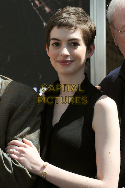 Anne Hathaway.attending Christopher Nolan Hand and Footprint Ceremony held at Grauman's Chinese Theatre, Hollywood, California, USA, 7th July 2012..half  length ruffle sleeveless peplum dress black .CAP/ADM/BP.©Byron Purvis/AdMedia/Capital Pictures.