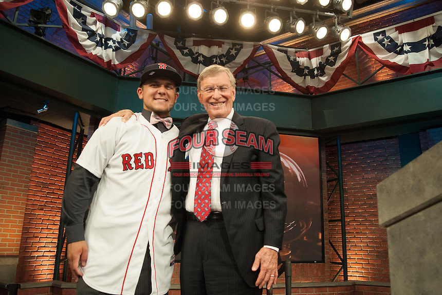 Infielder Michael Chavis (Sprayberry Senior H.S. (GA)) the number 26 overall pick to the Boston RedSox with Commissioner Bud Selig during the MLB Draft on Thursday June 05,2014 at Studio 42 in Secaucus, NJ.   (Tomasso DeRosa/ Four Seam Images)