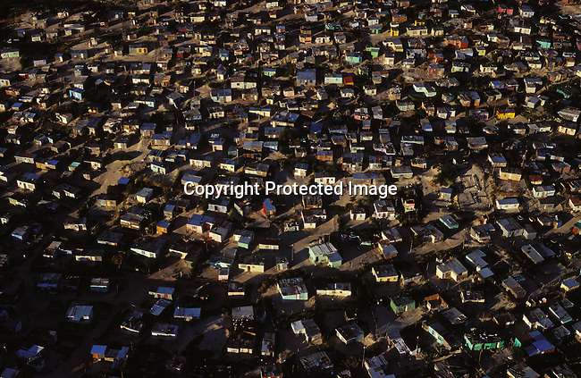 ditown00251.Digital. Townships. An aerial view of one of the poorest parts of Khayelitsha, SA on October 25 2003, where many newly arrived families live. People started moving into this township in 1984 and people are arriving every day from rural areas in the Eastern Cape looking for work in Cape Town.  Poverty. Densely populated. .©Per-Anders Pettersson/iAfrika Photos