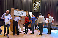 Employees preparing to create signage as part of an exercise at a corporate leadership forum.