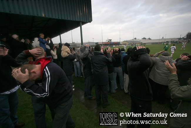 Burscough 3, Gillingham 2, 05/11/2005. Victoria Park, Burscough, FA Cup first round. Fans react with disbelief as the home team miss a good chance in the first-half. Burscough (in green) from the Northern Premier League Premier Division defeated their Football League Championship rivals by 3-2 with two goals in the last minute, watched by a crowd of 1927 spectators. Photo by Colin McPherson.