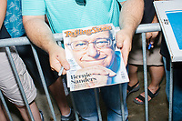People wait to get an autograph as Democratic presidential candidate Bernie Sanders speaks to the press at the Iowa State Fair in Des, Moines, Iowa, on Sun., Aug. 11, 2019.