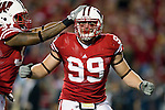 Wisconsin Badgers defensive lineman J.J. Watt (99) celebrates a tackle during an NCAA college football game against the Ohio State Buckeyes on October 16, 2010 at Camp Randall Stadium in Madison, Wisconsin. The Badgers beat the Buckeyes 31-18. (Photo by David Stluka)