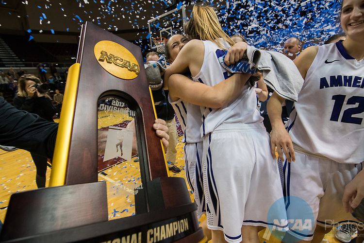 GRAND RAPIDS, MI - MARCH 18: Amherst College gets their first look at their winning trophy during the Division III Women's Basketball Championship held at Van Noord Arena on March 18, 2017 in Grand Rapids, Michigan. Amherst College defeated Tufts University 52-29 for the national title. (Photo by Brady Kenniston/NCAA Photos via Getty Images)