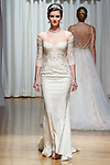 Model walks runway in a Hudson gown from the Beloved Bridal collection at the Casablanca Bridal 20th anniversary celebration runway show, on October 8, 2017; during New York Bridal Fashion Week Spring 2018.