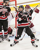 Kasidy Anderson (NU - 37), Shelby Herrington (NU - 6), Lexi Bender (BC - 21) - The Boston College Eagles defeated the Northeastern University Huskies 5-1 (EN) in their NCAA Quarterfinal on Saturday, March 12, 2016, at Kelley Rink in Conte Forum in Boston, Massachusetts.
