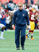 Dallas Cowboys head coach Jason Garrett watches his team warm-up prior to the game against the Washington Redskins at FedEx Field in Landover, Maryland on Sunday, December 28, 2014.  <br /> Credit: Ron Sachs / CNP