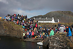'Crowds at the World Stone Skimming Championships, 2018' from Colin McPherson's project 'Treasured Island' part of the Document Scotland exhibition entitled 'A Contested Land' which will launch at the Martin Parr Foundation, Bristol, on 16th January, 2019. McPherson's work was made in 2018-2019 on Easdale, the smallest permanently inhabited Inner Hebridean island and looks at the historical legacy of the island, once world famous for its slate mining industry.<br /> <br /> Photograph © Colin McPherson, 2018 all rights reserved.