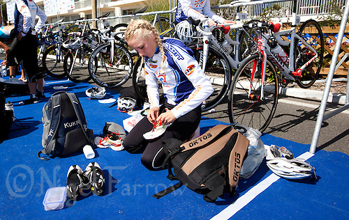 18 SEP 2010 - LA BAULE, FRA - Lois Rosindale (Montpellier Agglo Tri) prepares her running shoes in transition before the start of the 2010 Womens French Club Championship Final .(PHOTO (C) NIGEL FARROW)
