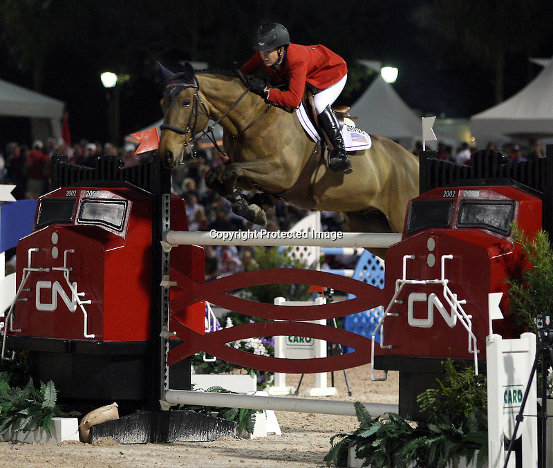 Lauren Hough and Quick Study compete for the United States of America in the final round of the $75,000 FEI Nations Cup, an Olympics-style show jumping event, on Friday night, Feb. 28, 2009, during the Winter Equestrian festival in Wellington, Fla. Canada won the eight-nation, two-round competition before the first sellout (8,000) at the recently-renovated Palm Beach International Equestrian Center. Canada edged Ireland and Great Britain (tie) for the blue ribbons, followed by the United States. Also competing were teams from Argentina, France, Mexico and Venezuela. Thousands of cheering, flag-waving fans packed the International Arena at the WEF grounds for the Nations Cup, reportedly the oldest and most prestigious team show jumping competition in the world. Photo by Bob Markey II