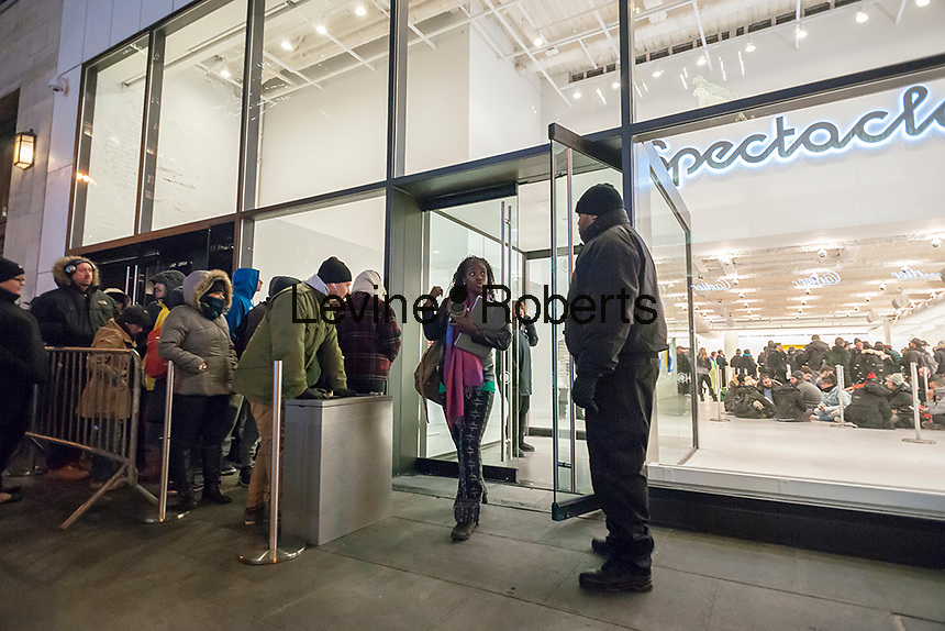 Hundreds of shoppers wait on line at the Spectacles pop-up store in New York on Tuesday, November 22, 2016. Snap, formerly Snapchat, opened the store to sell their very limited edition Spectacles, a high-tech pair of glasses with a camera which enables you to post a circular video you create to your Snapchat account. The glasses are sold by a lone vending machine as you wait up to seven hours by some accounts to access, when you can buy two at $129.95 each. (© Richard B. Levine)