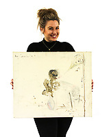 BNPS.co.uk (01202 558833)<br /> Pic: Sworders/BNPS<br /> <br /> Art from the Heart...Auctioneer Briony Harford with the strange work.<br /> <br /> A morbid self portrait by Pete Doherty of himself and Kate Moss drawn using his own blood has emerged for sale for £5,000.<br /> <br /> The Libertines frontman pictured himself with his supermodel then-girlfriend in the artwork which is believed to date from when they were a couple circa 2005.<br /> <br /> He gifted it to the current owner before the break-up of his high profile relationship with Moss in 2007. Now, the vendor is selling the crayon and blood portrait with auctioneer Sworders, of Stansted Mountfitchet, Essex.<br /> <br /> Moss's head can be made out on the right side of the portrait, which has the inscription 'Ray Heads the son'.<br /> <br /> There is also a vase drawn in crayon with a darker figure emerging from it which is thought to represent Doherty.