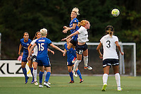 Seattle, Washington -  Sunday, September 11 2016: Seattle Reign FC midfielder Jessica Fishlock (10) and Washington Spirit midfielder Tori Huster (23) go up for a header during a regular season National Women's Soccer League (NWSL) match between the Seattle Reign FC and the Washington Spirit at Memorial Stadium. Seattle won 2-0.