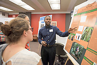 """Marvin Browne '16 presents his research on """"Characterization of Nutrient Uptake in Tank Bromeliads."""" After researching all summer, Occidental College students present their work at the annual Summer Undergraduate Research Conference on July 29, 2015.<br /> (Photo by Marc Campos, Occidental College Photographer)"""