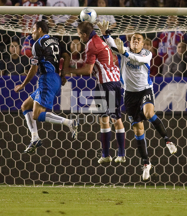 San Jose Earthquakes goalkeeper Andrew Weber and midfielder Ramiro Corrales battle with Chivas USA forward Justin Braun. Chivas USA and the San Jose Earthquakes played to a 2-2 draw at Home Depot Center stadium in Carson, California on Saturday October 17, 2009...