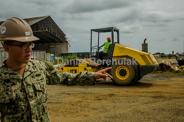 MONROVIA, LIBERIA - SEPTEMBER 30, 2014: A team of U.S. Navy engineers prepares the ground for a 25-bed medical facility they are building next to the airport in Monrovia on September 30, 2014 in Monrovia, Liberia. <br /> <br /> Daniel Berehulak for The New York Times