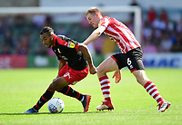Lincoln City's Scott Wharton vies for possession with Swindon Town's Keshi Anderson<br /> <br /> Photographer Chris Vaughan/CameraSport<br /> <br /> The EFL Sky Bet League Two - Lincoln City v Swindon Town - Saturday 11th August 2018 - Sincil Bank - Lincoln<br /> <br /> World Copyright &copy; 2018 CameraSport. All rights reserved. 43 Linden Ave. Countesthorpe. Leicester. England. LE8 5PG - Tel: +44 (0) 116 277 4147 - admin@camerasport.com - www.camerasport.com