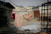 Clothes of migrant workers hang at the construction site of Changxiang Gardens development complex in Fengrun District, Tangshan City, Hebei province, China January 28, 2016. REUTERS/Damir Sagolj