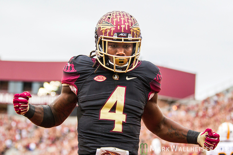 Florida State running back Dalvin Cook celebrates a 13 yard touchdown run in the first half of an NCAA college football game against Chattanooga in Tallahassee, Fla., Saturday, Nov. 21, 2015.  (AP Photo/Mark Wallheiser)