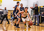 WATERBURY, CT. 09 January 2020-010920BS207 - Kaynor Tech's Scott Dalesio (2) dribble drives around Wolcott Tech's David Sidoti (21), as Wolcott Tech's Anthony Petersen (2) looks on from behind, during a Boy Basketball game between Wolcott Tech and Kaynor Tech at Kaynor Tech in Waterbury on Thursday. Bill Shettle Republican-American