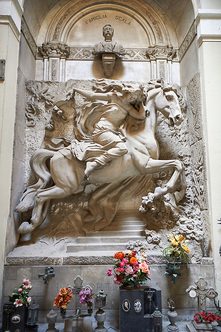 Pictures of the stone sculptured monumental tombs of a women on a charging horse. The Scala Tomb sculpted by E Sclavi 1913. Section A, no 36, The Staglieno Monumental Cemetery, Genoa, Italy