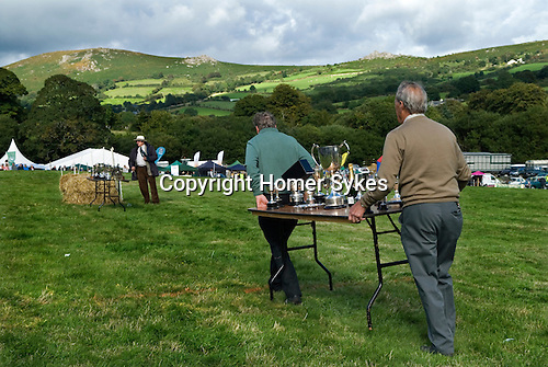 Widecombe Fair Widecombe in the Moor Dartmoor Devon Uk. Tables with siler cups. The church of Saint Pancras.