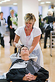 Instructor working on a client in the Arena Salon, Hair & Beauty Dept., Kingston College.
