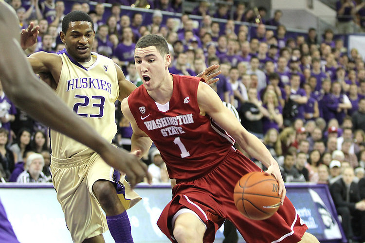 Klay Thompson (#1), Washington State junior guard, drives past C.J. Wilcox (#23) to the hoop for two of his 26 points during the Cougars 80-69 road victory over arch-rival Washington at the Alaska Airlines Arena in Seattle, Washington, on February 27, 2011.  With the victory, Thompson and the Cougars swept the regular season series from the Huskies, two games to none.