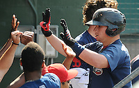 Catcher Christian Vazquez (15) of the Greenville Drive is congratulated hitting a home run in the first game of a doubleheader against the Rome Braves on August 15, 2011, at Fluor Field at the West End in Greenville, South Carolina. (Tom Priddy/Four Seam Images)