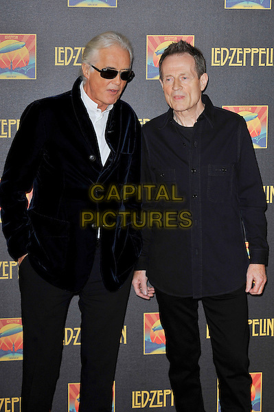 Jimmy Page and John Paul Jones .Attending the Led Zeppelin 'Celebration Day' UK premiere, Hammersmith Apollo, London, England. 12th October 2012..half 3/4 length black sunglasses navy blue velvet jacket  .CAP/MAR.© Martin Harris/Capital Pictures.