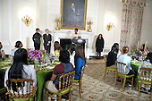 Washington, DC - November 24, 2009 -- First lady Michelle Obama makes remarks as she hosts young women from the White House Leadership and Mentoring Program in the State Dining Room of the White House on Tuesday, November 24, 2009.  .Credit: Ron Sachs / CNP.(RESTRICTION: NO New York or New Jersey Newspapers or newspapers within a 75 mile radius of New York City)