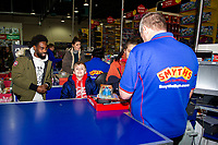 Pictured: Nathan Dyer of Swansea City buying children gifts at Smyth's Toy Store, in Swansea, Wales, UK. Wednesday 19 December 2018