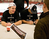 Luke Greiner (Harvard - 26) chats with young fans. - The Yale University Bulldogs defeated the Harvard University Crimson 5-1 on Saturday, November 3, 2012, at Bright Hockey Center in Boston, Massachusetts.