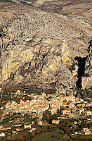 Moustiers-Ste.Marie. Aerial of village and mountains. Alpes de Haute Provence. France. There is a large gilded star suspended on an iron chain between the two hillsides in the background, reputed to have been installed by the Chevallier de Blacas on his return from the Crusades