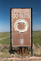 Abandoned donut shop sign near Atwood, CO