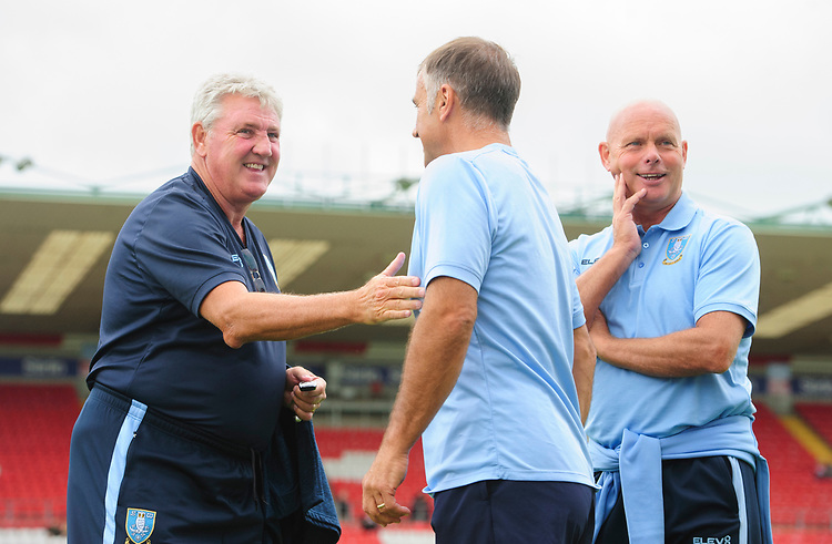 Sheffield Wednesday's manager Steve Bruce, left, and Sheffield Wednesday's under-23 manager Neil Thompson prior to the game<br /> <br /> Photographer Chris Vaughan/CameraSport<br /> <br /> Football Pre-Season Friendly - Lincoln City v Sheffield Wednesday - Saturday July 13th 2019 - Sincil Bank - Lincoln<br /> <br /> World Copyright © 2019 CameraSport. All rights reserved. 43 Linden Ave. Countesthorpe. Leicester. England. LE8 5PG - Tel: +44 (0) 116 277 4147 - admin@camerasport.com - www.camerasport.com