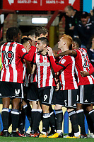 Neal Maupay of Brentford is congratulated for his goal during the Sky Bet Championship match between Brentford and Leeds United at Griffin Park, London, England on 4 November 2017. Photo by Carlton Myrie.