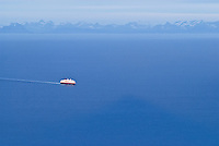 Hurtigruten, Norwegian coastal steamer traveling through Vestfjort to Stamsund, Lofoten, Norway