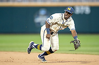 Michigan Wolverines second baseman Ako Thomas (4) dives for a grounder against the Vanderbilt Commodores during Game 1 of the NCAA College World Series Finals on June 24, 2019 at TD Ameritrade Park in Omaha, Nebraska. Michigan defeated Vanderbilt 7-4. (Andrew Woolley/Four Seam Images)