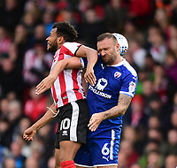 Lincoln City's Matt Green vies for possession with Chesterfield's Ian Evatt<br /> <br /> Photographer Chris Vaughan/CameraSport<br /> <br /> The EFL Sky Bet League Two - Lincoln City v Chesterfield - Saturday 7th October 2017 - Sincil Bank - Lincoln<br /> <br /> World Copyright &copy; 2017 CameraSport. All rights reserved. 43 Linden Ave. Countesthorpe. Leicester. England. LE8 5PG - Tel: +44 (0) 116 277 4147 - admin@camerasport.com - www.camerasport.com