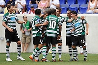 Jaime Valdes (15) of Sporting Clube de Portugal (R) celebrates soring with teammates. Tottenham Hotspur F. C. and Sporting Clube de Portugal played to a 2-2 tie during a Barclays New York Challenge match at Red Bull Arena in Harrison, NJ, on July 25, 2010.