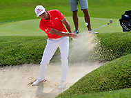 Potomac, MD - June 29, 2017: Rickie Fowler plays a shot from the bunker on the 15th hole during Round 1 of professional play at the Quicken Loans National Tournament at TPC Potomac at Avenel Farm in Potomac, MD, June 29, 2017.  (Photo by Don Baxter/Media Images International)