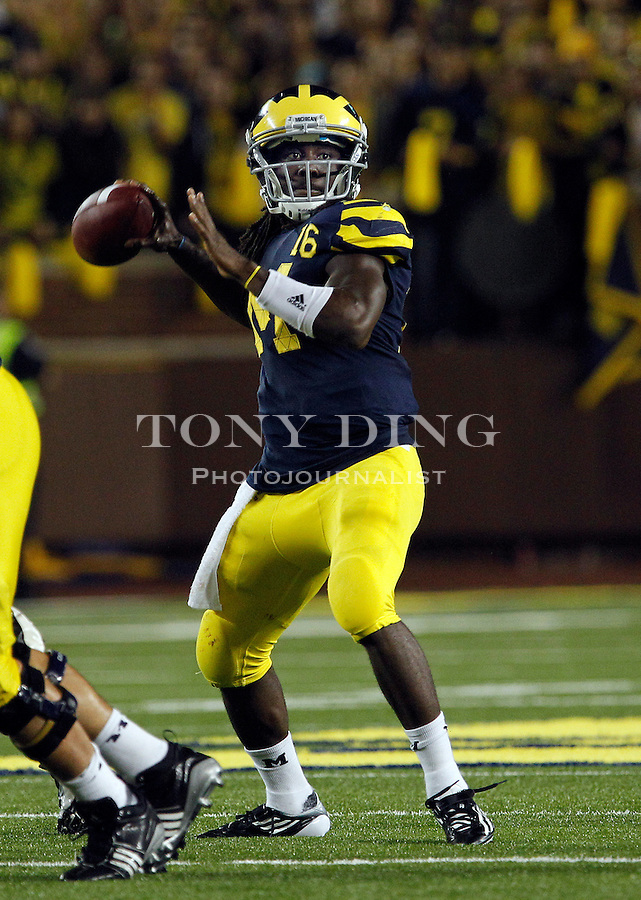 Michigan quarterback Denard Robinson (16) throws a pass in the fourth quarter of an NCAA college football game against Notre Dame, Saturday, Sept. 10, 2011, in Ann Arbor. Michigan won 35-31. (AP Photo/Tony Ding)