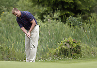 June 23, 2008:  Former Seattle Seahawks and University of Washington quarterback Brock Huard chips his ball to the green on hole #4 while playing in the Detlef Schrempf celebrity golf classic held at McCormick Woods golf club in Port Orchard, WA.