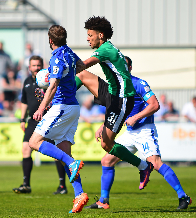Lincoln City's Lee Angol vies for possession with Eastleigh's Paul Reid<br /> <br /> Photographer Andrew Vaughan/CameraSport<br /> <br /> Vanarama National League - Eastleigh v Lincoln City - Saturday 8th April 2017 - Silverlake Stadium - Eastleigh<br /> <br /> World Copyright &copy; 2017 CameraSport. All rights reserved. 43 Linden Ave. Countesthorpe. Leicester. England. LE8 5PG - Tel: +44 (0) 116 277 4147 - admin@camerasport.com - www.camerasport.com
